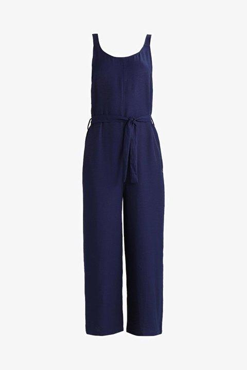 Mono Clemanthe de color azul, tirantes y cinturón.
