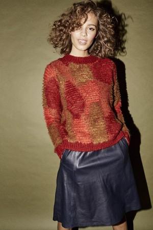 Jersey de punto de Nümph en distintos tonos de rojos y verdes.