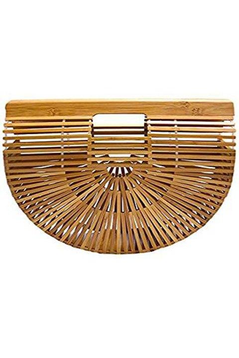 Bolso de mano rígido, realizado en bambú y en color natural.