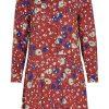 Numederie. Vestido de corte camisero hasta cintura con estampado leopardo en tonos nada convencionales.